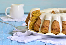 Carrot cake with cream glaze. Royalty Free Stock Image