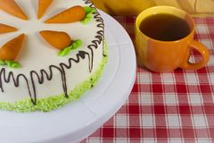 Carrot cake and a cup of tea Royalty Free Stock Image