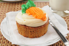 Carrot cake. A carrot cake cupcake with a glass of milk Royalty Free Stock Photos