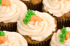 Carrot Cake Cupcakes. Many Carrot Cake Cupcakes with a buttercreme carrot on top Royalty Free Stock Image