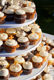 Carrot Cake Cupcakes. Wedding cupcakes of chocolate, vanilla, and carrotcake at a wedding reception Stock Photo
