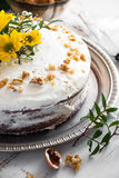 Carrot cake decorated with flowers Royalty Free Stock Photography