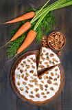 Carrot cake and fresh carrot on wooden table Royalty Free Stock Photos