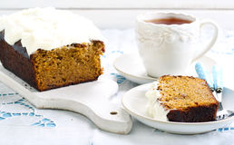 Carrot cake with frosting Royalty Free Stock Photos