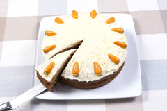 Carrot cake. A home made carrot cake with butter cream being sliced stock images
