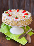 Carrot cake with icing and little carrots Royalty Free Stock Photo