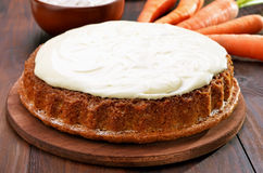 Carrot cake with icing Stock Images