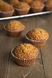 Carrot cake muffin. S on a wood table royalty free stock photo