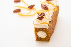 Carrot cake pie, sprinkled with nuts, decorated with cream-colored carrots on white marble. Carrot cake pie, sprinkled with nuts, decorated with cream-colored stock image