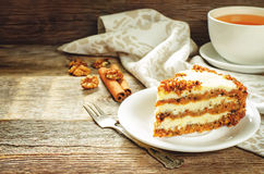Carrot cake with raisins, walnuts and butter cream Royalty Free Stock Image