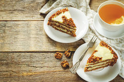 Carrot cake with raisins, walnuts and butter cream Royalty Free Stock Photo