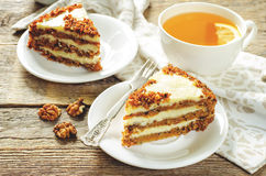 Carrot cake with raisins, walnuts and butter cream Stock Photos