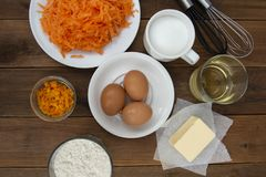 Carrot cake recipe. Making dough for carrot cake, pie, muffins or tart, on kitchen table - eggs, flour, butter, orange, citrus,. Oil sugar stock images
