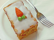Carrot cake on saucer with fork Stock Photography