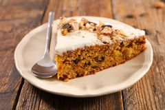 Carrot cake slice. On wood royalty free stock photography