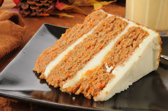 Carrot cake. A slice of gourmet carrot cake with eggnog on a holiday table Royalty Free Stock Image
