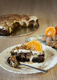 Carrot cake sprinkled with walnuts and mandarine slices Stock Photo