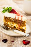 Carrot cake with strawberry sauce Royalty Free Stock Photos