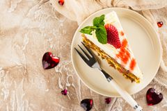 Carrot cake with strawberry sauce Stock Image