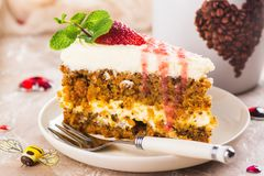 Carrot cake with strawberry sauce Royalty Free Stock Images