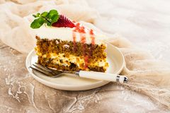Carrot cake with strawberry sauce Royalty Free Stock Image