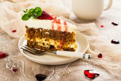 Carrot cake with strawberry sauce Royalty Free Stock Photography