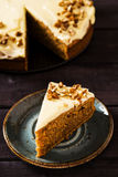 Carrot cake. Super moist carrot cake icing with cream cheese decorated pecans Stock Photography
