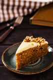 Carrot cake. Super moist carrot cake icing with cream cheese decorated pecans Stock Images
