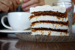 Carrot cake with thick cream cheese frosting Stock Images
