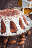 Carrot cake with vanilla cream. And almonds Stock Image