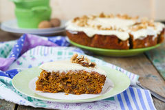Carrot cake with walnuts and cream.  Royalty Free Stock Photography