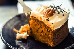 Carrot cake with walnuts, prunes and dried apricots on a dark  background. tinting. selective focus .dessert idea background stock photos