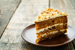 Carrot cake with walnuts, prunes and dried apricots Royalty Free Stock Photo