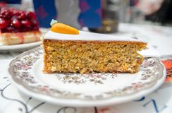 Carrot cake with walnuts and prunes. Served on plate royalty free stock images