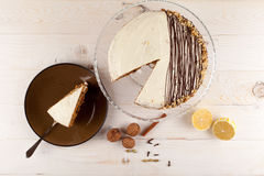 Carrot cake with walnuts and white cream. Top view. Royalty Free Stock Photography