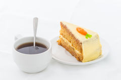 Carrot Cake on white dish with hot drink Royalty Free Stock Image