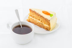 Carrot Cake on white dish with hot drink Royalty Free Stock Photo