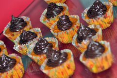 Carrot and chocolate cupcakes. In paper forms Royalty Free Stock Images