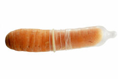 Carrot and condom condon isolated on white Royalty Free Stock Photo