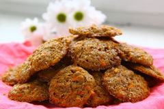 Carrot cookies on the pink tissue close up photo Stock Photos