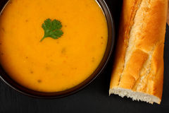Carrot and coriander soup. With bread stick Royalty Free Stock Image