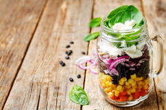 Carrot corn black beans red onion feta spinach salad Royalty Free Stock Image
