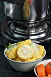 Carrot and corn vegeteble material. Wait for do soup in the kitchen royalty free stock photo