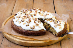 Carrot and courgette cake. With nuts and raisin, with yogurt frosting royalty free stock image