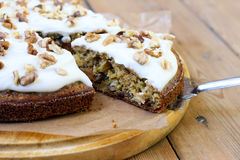 Carrot and courgette cake. With nuts and raisin, with yogurt frosting stock photo