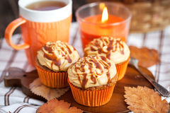 Carrot cupcakes with caramel cream cheese topping. Carrot cupcakes decorated with cream cheese and caramel topping Royalty Free Stock Images