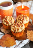 Carrot cupcakes with caramel cream cheese topping Royalty Free Stock Image