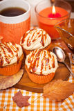 Carrot cupcakes with caramel cream cheese topping Stock Photos