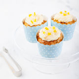 Carrot cupcakes decorated with cream cheese frosting Royalty Free Stock Images