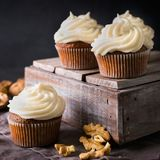 Carrot cupcakes or muffins with nuts on dark background. Copy space, square Stock Photo